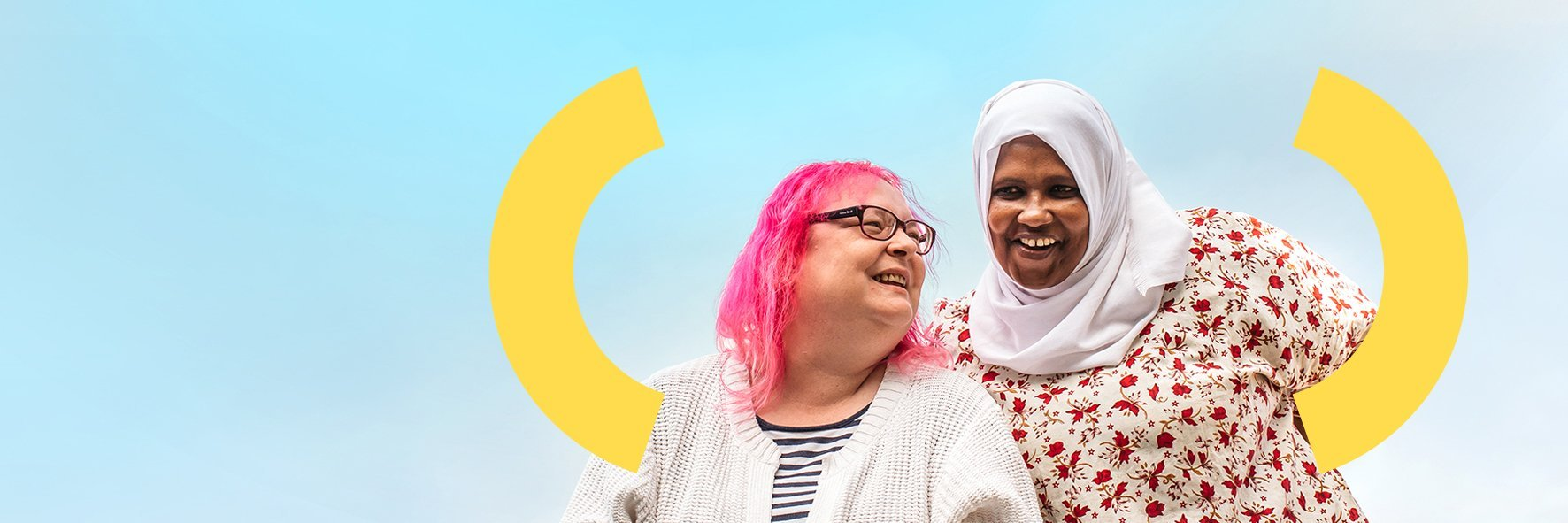 Befriending member Leila and volunteer Halima smiling with each other